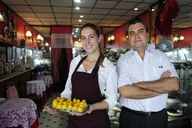 Owner and staff in  family-owned restaurant